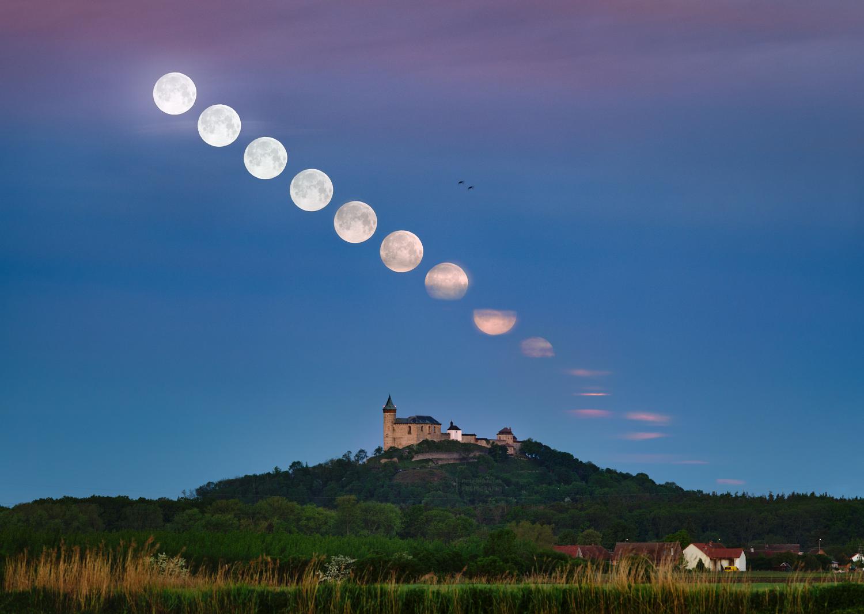 Setting Flower Moon over Kunetice Castle